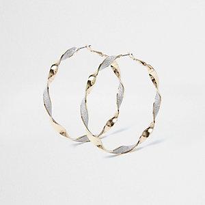 Gold tone glitter twist hoop earrings