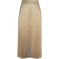 Jupe mi-longue plissée dorée métallisée