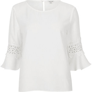 White satin crochet flute sleeve top