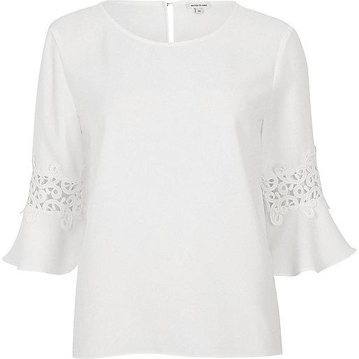White satin crochet flute sleeve top