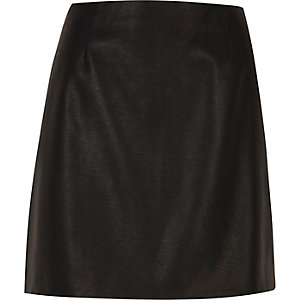 Black leather look mini skirt