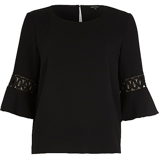 Top noir avec empiècements en velours côtelé et manches pagode