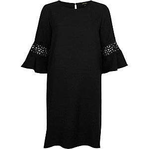 Black trumpet sleeve swing dress