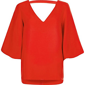 Red plunge puff sleeve top