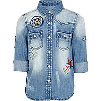 Girls blue mid wash denim badge shirt