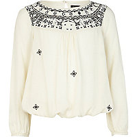 Girls cream embroidered trapped hem shirt