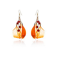 Girls orange feather earrings