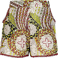 Girls green tribal print shorts