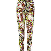 Girls green tribal print trousers