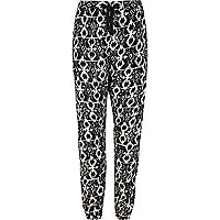 Girls black aztec print trousers