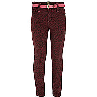 Girls red animal print skinny jeans