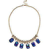 Girls blue gem and skull statement necklace