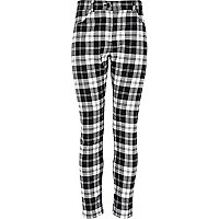 Girls black tartan trousers