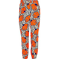 Girls orange polka dot floral print trousers
