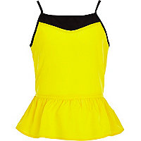 Girls yellow colour block peplum vest top