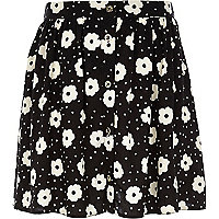 Girls black daisy button through skirt