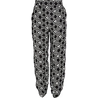 Girls black eye print trousers
