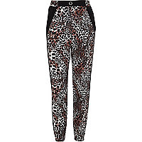 Girls black animal print trousers