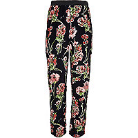 Girls black floral trousers