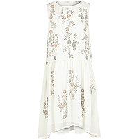 Girls cream embellished dip hem dress