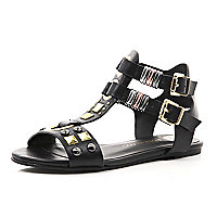 Girls black gold tone stud gladiators