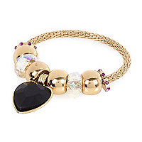 Girls gold tone black heart charm bracelet