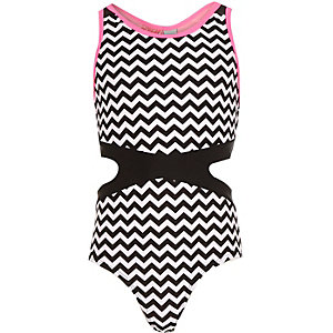 Girls black zig zag cut out swimsuit