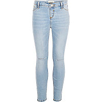 Girls light wash ripped knee jeggings