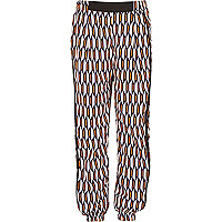 Girls orange geo print joggers