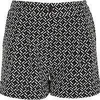 Girls black geo print shorts