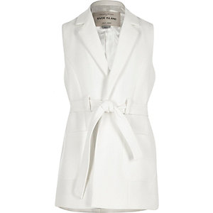 Girls cream belted sleeveless jacket