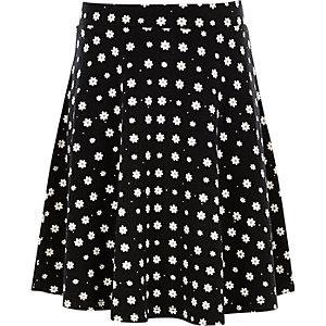 Girls black daisy print skater skirt