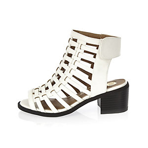 Girls white caged heel shoes