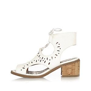 Girls white laser cut heel shoes