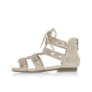 Sandales en dentelle dorée