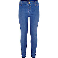 Girls bright blue chewed skinny jeans