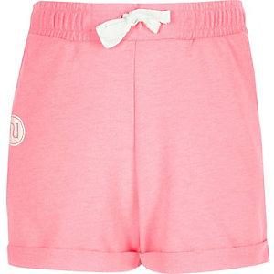 Girls pink boxy badge shorts