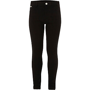 Girls black skinny trousers