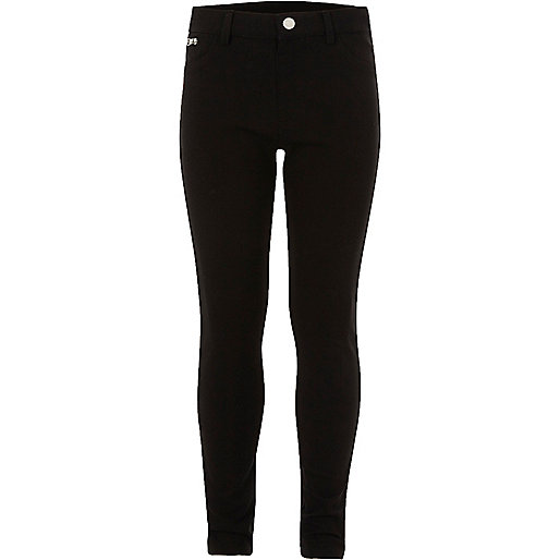 Girls black skinny trousers