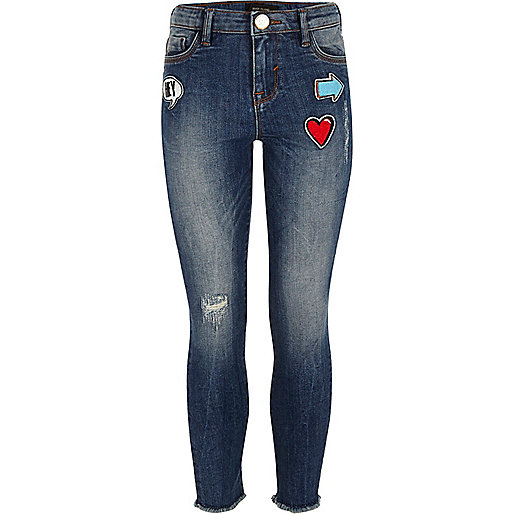 Girls blue faded badge skinny jeans