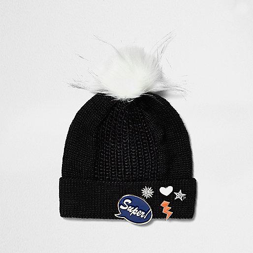 Girls black knit badge bobble hat