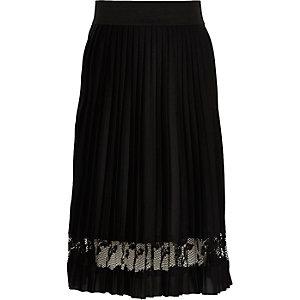 Jupe mi-longue noire plissée avec empiècement en dentelle pour fille