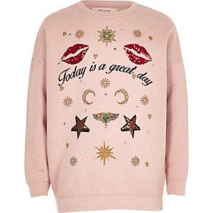 Pinkes Sweatshirt mit Paillettenverzierung