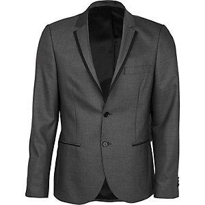 Veste de costume grise cintrée avec détails contrastants