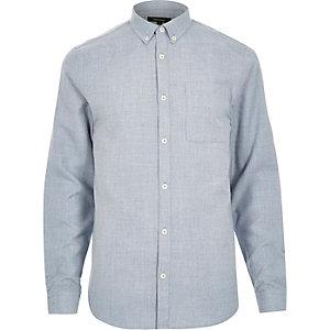 Chemise en flanelle bleue à manches longues coupe cintrée