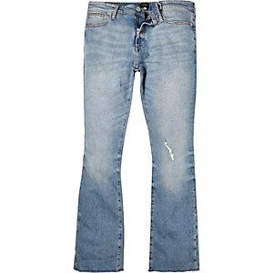 Mid wash raw hem Sid skinny kickflare jeans