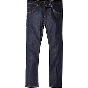 Dark wash tapered skinny jeans