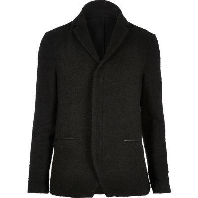 Zwart jasje van gekookte wol