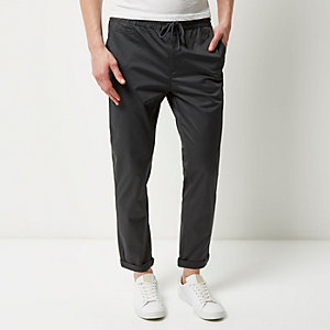 Dark green pull on trousers