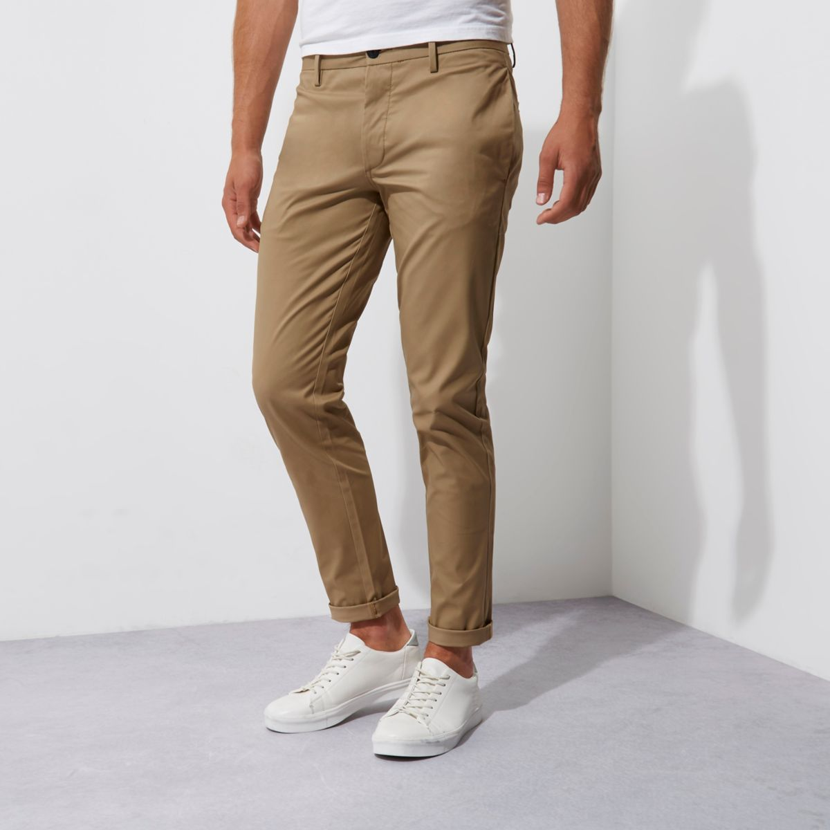 "The terms ""khakis"" and ""chinos"" are often used interchangeably, though the correct word is actually chino, which applies to the actual pants themselves. Khaki is, arguably, the most common color of chinos – which is probably why the terminology gets confusing."
